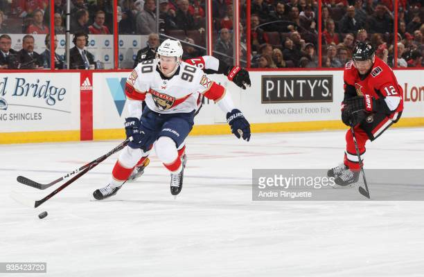 Leading to his second period goal Jared McCann of the Florida Panthers skates with the puck on a breakaway against Ben Harpur and Marian Gaborik of...