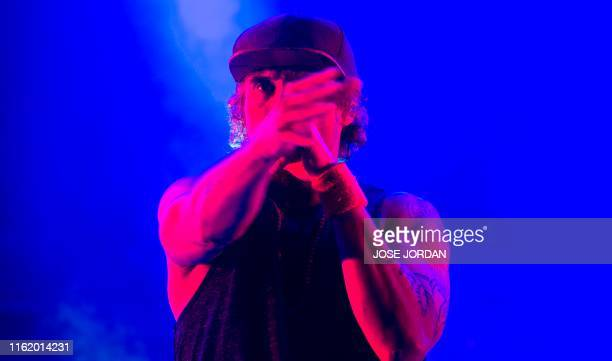 "Leading vocalist of ""Macaco"" band, Spanish singer Dani Carbonell, performs during the first day of the Rototom Sunsplash European Reggae Festival in..."