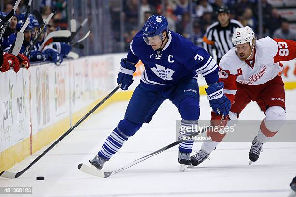 TORONTO MARCH 29 Leaf Captain Dion Phanneuf fends off Detroits Johan Franzen Toronto Maple Leafs vs Detroit Red Wings during 3rd period NHL action on...