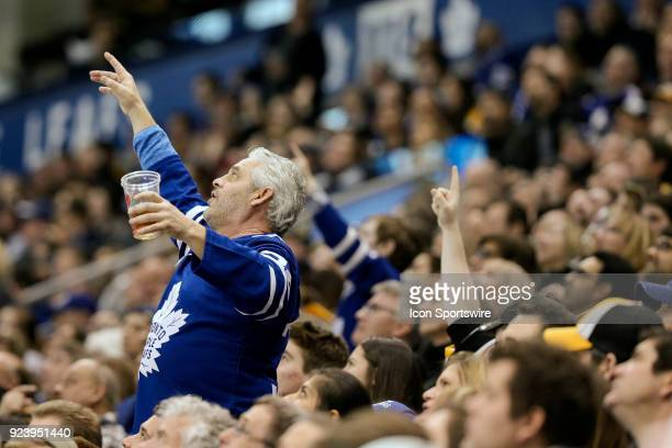A leaf fan gestures at the video board during review of play during the regular season NHL game between the Boston Bruins and the Toronto Maple Leafs...