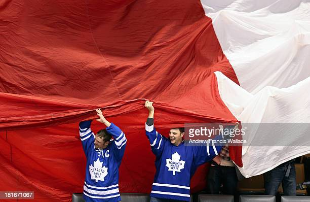 TORONTO ON SEPTEMBER 22 Leaf fans pull along a large Canadian flag prior to Toronto Maple Leafs and Buffalo Sabres NHL preseason game at Air Canada...