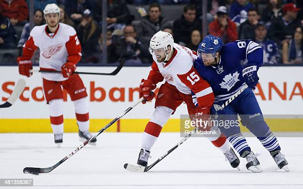 TORONTO MARCH 29 Leaf forward Phil Kessel tries to move Wings Riley Sheahan off the puck Toronto Maple Leafs vs Detroit Red Wings during 2nd period...