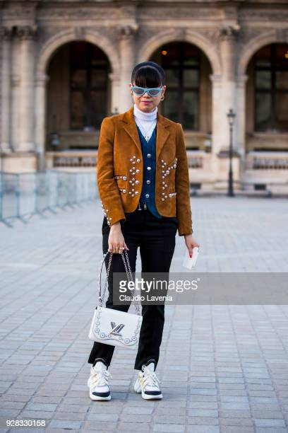 Leaf Greener is seen in the streets of Paris before the Louis Vuitton show during Paris Fashion Week Womenswear Fall/Winter 2018/2019 on March 6 2018...