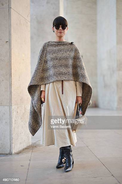 Leaf Greener poses wearing a Lemaire dress and JW Anderson shoes and bag before the Rochas show at the Palais de Tokyo during Paris Fashion Week SS16...