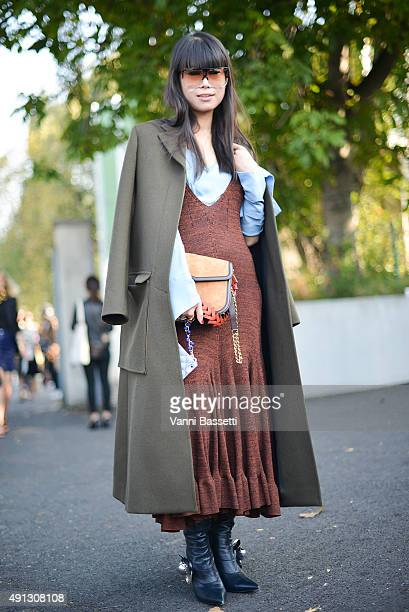 Leaf Greener poses wearing Celine coat and dress JW Anderson shoes and Loewe bag before the Kenzo show at the Paris Event Center during Paris Fashion...