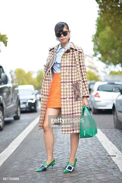 Leaf Greener poses wearing Miu Miu and Delpozo bag before the Miu Miu show at the Palais de Iena during Paris Fashion Week SS16 on October 7 2015 in...