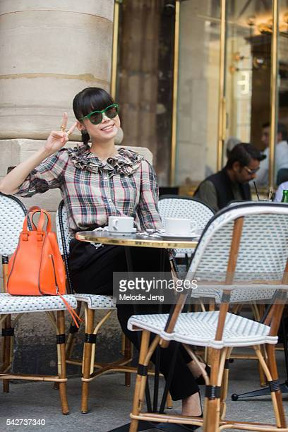 Leaf Greener sits at a cafe with a Loewe bag at the Louis Vuitton show during Paris Men's Fashion Week SS17 on June 23 2016 in Paris France