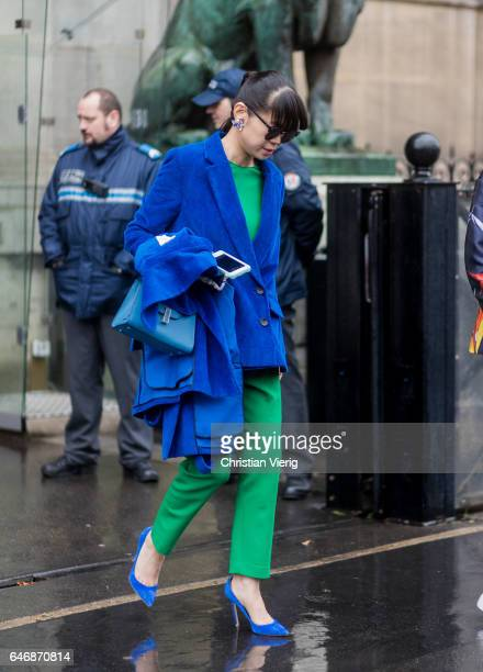 Leaf Greener wearing a blue blazer jacket green pants outside Lanvinon March 1 2017 in Paris France