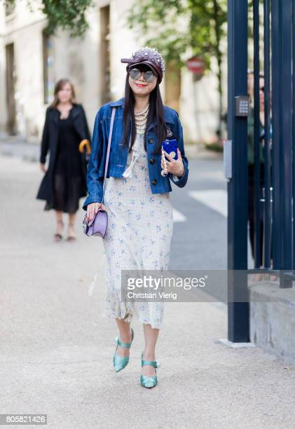 Leaf Greener wearing a dress Miu Miu jacket cap outside Rodarte during Paris Fashion Week Haute Couture Fall/Winter 20172018 Day One on July 2 2017...