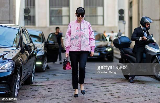 Leaf Greener wearing a pink bomber jacket outside Ferragamo during Milan Fashion Week Spring/Summer 2017 on September 25 2016 in Milan Italy