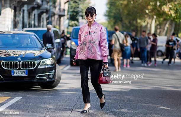 Leaf Greener wearing a pink bomber jacket outside Marni during Milan Fashion Week Spring/Summer 2017 on September 25 2016 in Milan Italy