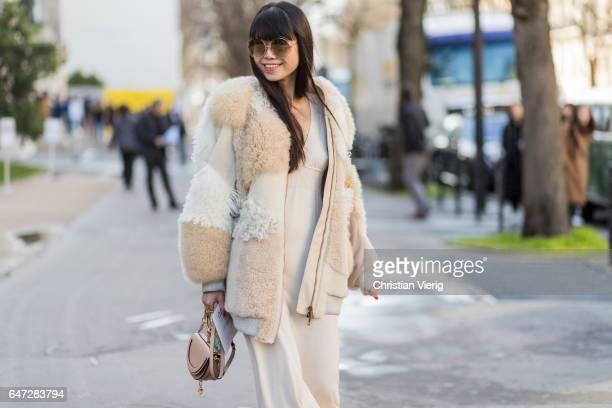 Leaf Greener wearing a white fur coat Converse sneaker Chloe bag outside Chloe on March 2 2017 in Paris France
