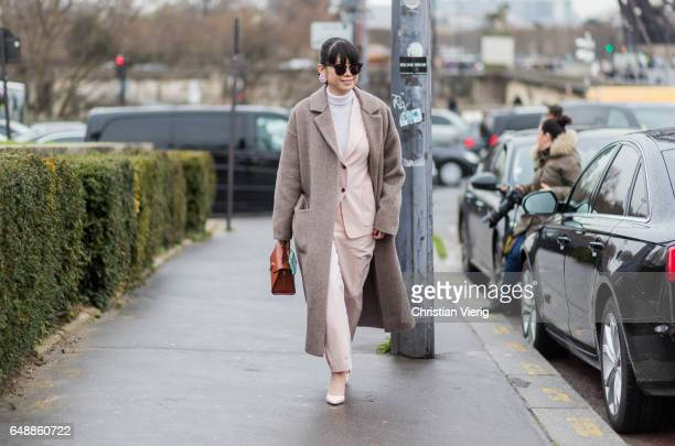 Leaf Greener wearing a wool coat pastel suit outside Hermes on March 6 2017 in Paris France