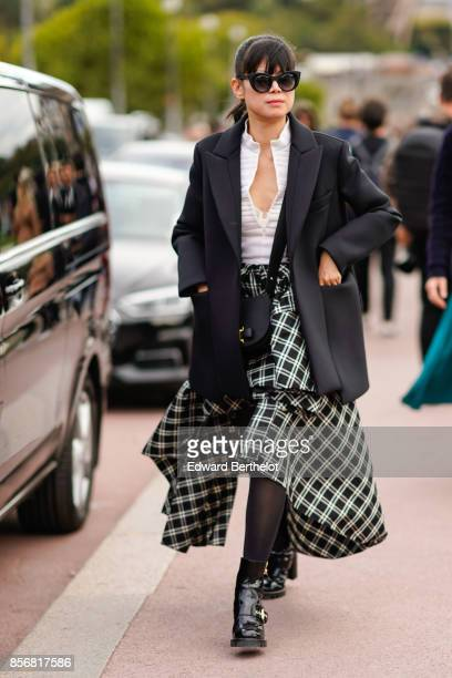 Leaf Greener wears a blazer jacket a checkered skirt outside Hermes during Paris Fashion Week Womenswear Spring/Summer 2018 on October 2 2017 in...