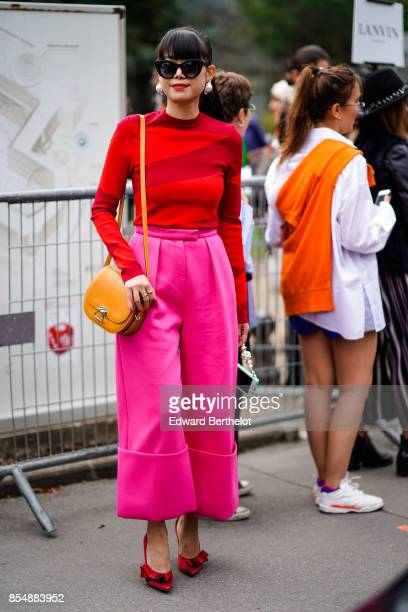Leaf Greener wears a red top pink pants outside Lanvin during Paris Fashion Week Womenswear Spring/Summer 2018 on September 27 2017 in Paris France
