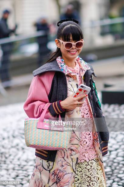 Leaf Greener wears sunglasses a bomber jacket a flower print coat a dress outside Miu Miu during Paris Fashion Week Womenswear Fall/Winter 2018/2019...