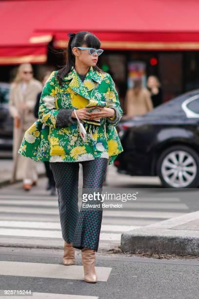 Leaf Greener wears sunglasses a floer print jacket flare pants during Paris Fashion Week Womenswear Fall/Winter 2018/2019 on February 28 2018 in...