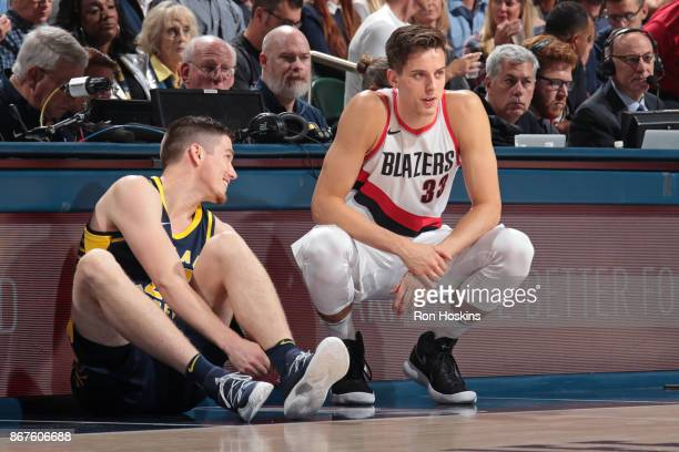 J Leaf of the Indiana Pacers and Zach Collins of the Portland Trail Blazers talk during the game on October 20 2017 at Bankers Life Fieldhouse in...