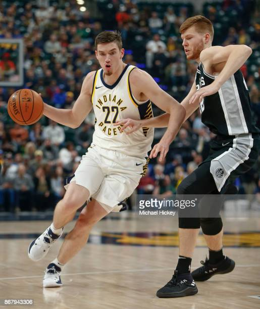 J Leaf of the Indiana Pacers drives to the basket against Davis Bertans of the San Antonio Spurs at Bankers Life Fieldhouse on October 29 2017 in...