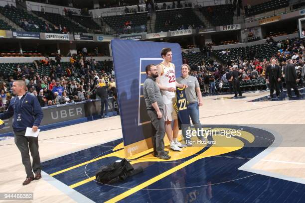 J Leaf of the Indiana Pacers poses for a photo with fans after the game against the Charlotte Hornets on April 10 2018 at Bankers Life Fieldhouse in...