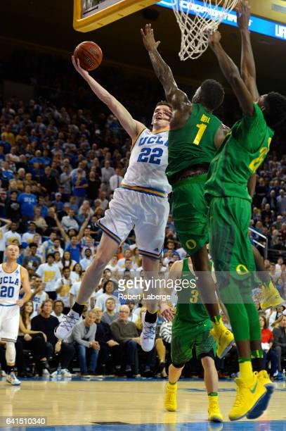 Leaf of the UCLA Bruins attempts a lay up against Jordan Bell and Chris Boucher the Oregon Ducks at Pauley Pavilion on February 9 2017 in Los Angeles...