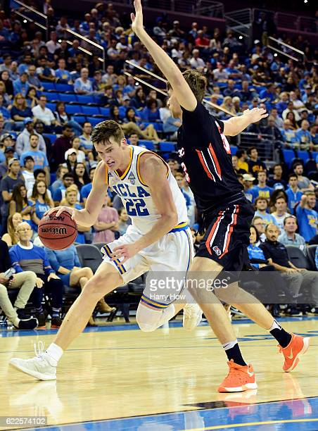 Leaf of the UCLA Bruins drives on Ilias Theodorou of the Pacific Tigers during a 11980 UCLA win at Pauley Pavilion on November 11 2016 in Los Angeles...
