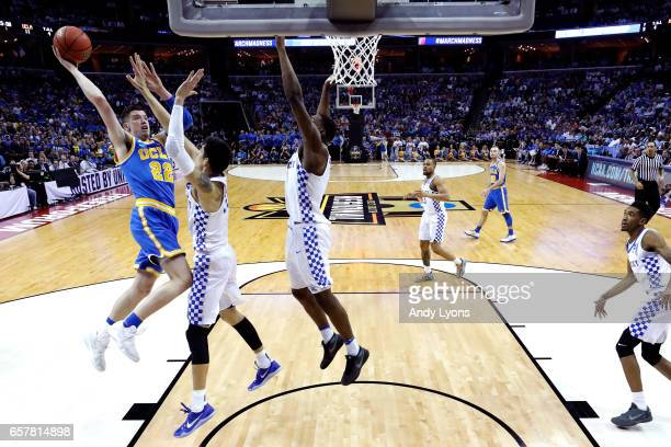 Leaf of the UCLA Bruins drives to the basket against Derek Willis of the Kentucky Wildcats in the first half during the 2017 NCAA Men's Basketball...