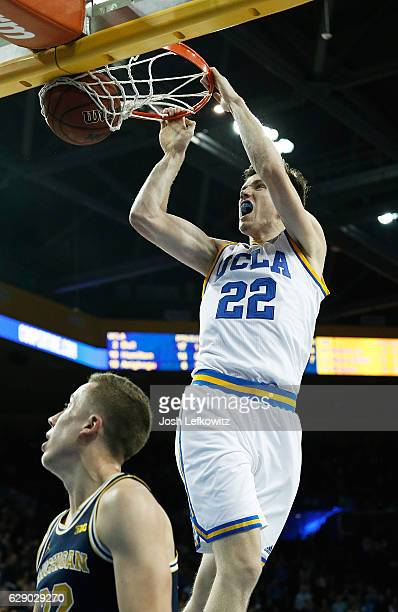 J Leaf of the UCLA Bruins dunks the ball at Pauley Pavilion during their game against the University of Michigan on December 10 2016 in Los Angeles...