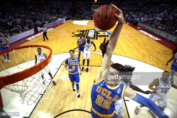 Leaf of the UCLA Bruins goes up for a dunk against Wenyen Gabriel of the Kentucky Wildcats in the first half during the 2017 NCAA Men's Basketball...