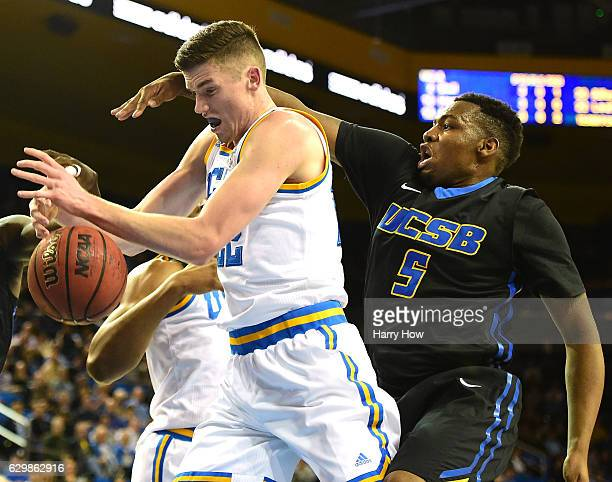 Leaf of the UCLA Bruins grabs possession of a rebound in front of Jalen Canty of the UC Santa Barbara Gauchos at Pauley Pavilion on December 14 2016...