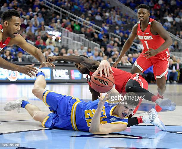 Leaf of the UCLA Bruins passes from the floor in front of Kam Williams of the Ohio State Buckeyes during the CBS Sports Classic at TMobile Arena on...