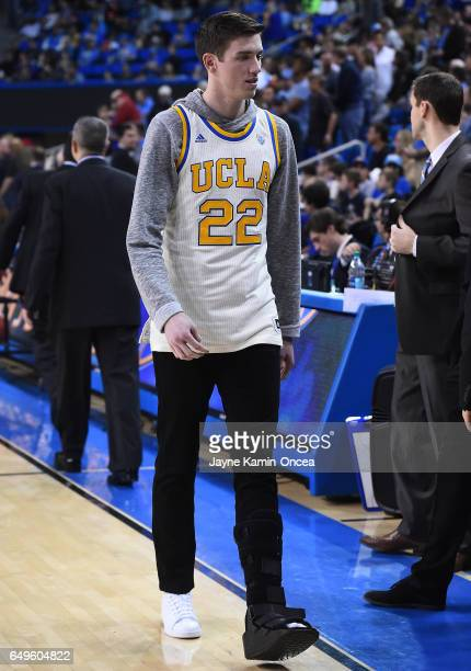 Leaf of the UCLA Bruins walks with a boot on his sprained ankle during warm ups before the game against the Washington State Cougars at Pauley...