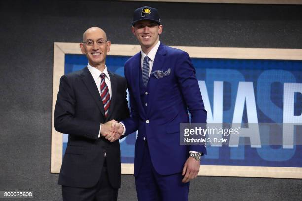 J Leaf shakes hands with NBA Commissioner Adam Silver after being selected number eighteen overall by the Indiana Pacers during the 2017 NBA Draft on...