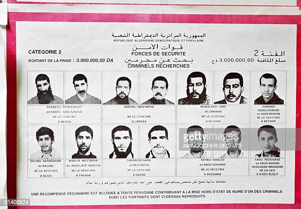 A leaflet displaying pictures of alleged Algerian terrorist of Islamic armed groups is pasted on a wall at Algiers airport 09 April 1999 offering a...