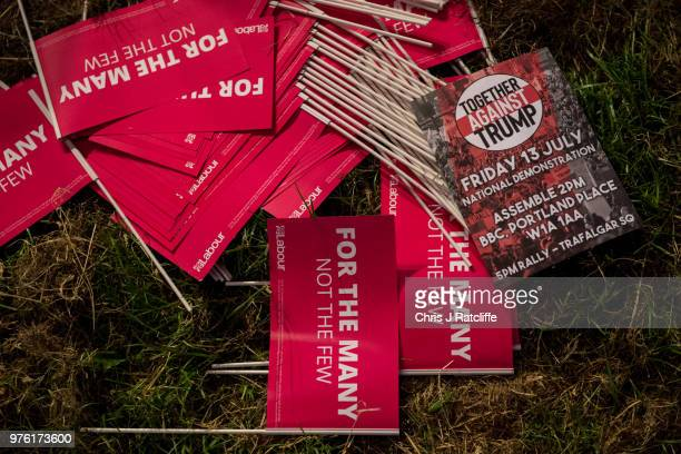A leaflet for a protest against Donald Trump is seen amongst Labour party flags at the Solidarity Tent at Labour Live White Hart Lane Tottenham on...