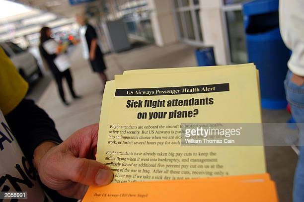 A leaflet handed out by US Airways flight attendants represented by the Association of Flight Attendants AFLCIO is shown as they picket to protest...