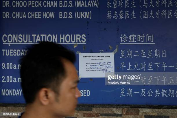 A leaflet is attached on a closed shop during Chinese New Year celebration in Kuala Lumpur Malaysia on February 5 2019 Malaysian government set...