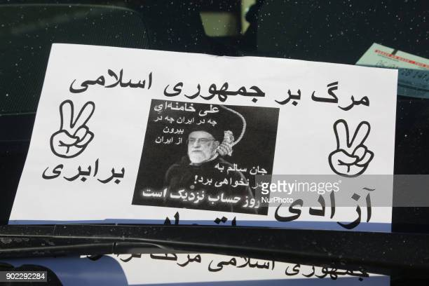 Leaflet on the windshield of a vehicle as hundreds of Canadians take part in a protest against the Islamic Republic of Iran in Toronto Ontario Canada...
