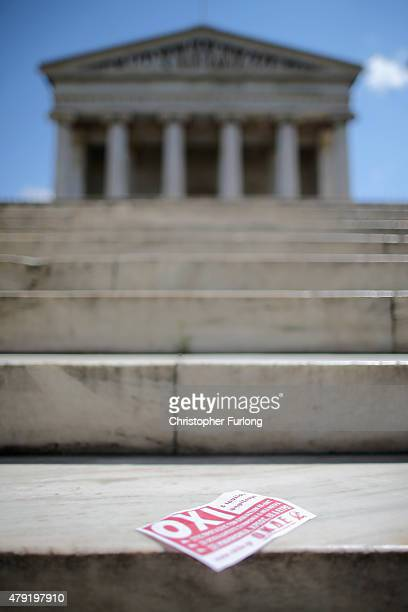 A leaflet saying 'OXI' meaning 'NO' to austerity blows in the wind across the marble steps of the Athens Academy building on July 2 2015 in Athens...