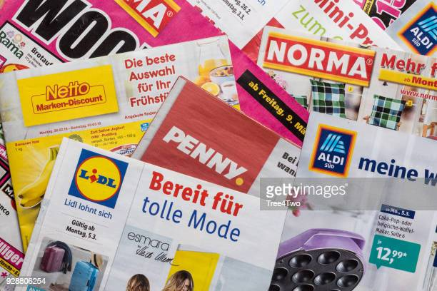 leaflets and flyers of german discount market chains - flyer leaflet stock photos and pictures