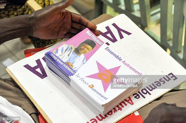 Leaflets picturing former Burkina Faso's Foreign Minister and 'Faso Autrement' party's leader Ablasse Ouedraogo are display on June 7 2015 after the...