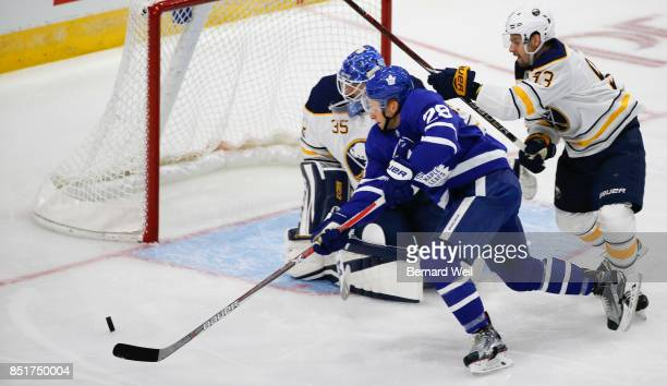 TORONTO ON SEPTEMBER 22 Leafs' Connor Brown can't make the shot as Sabres' Victor Antipin and goalie Linus Ullmark look on in 1st period action as...