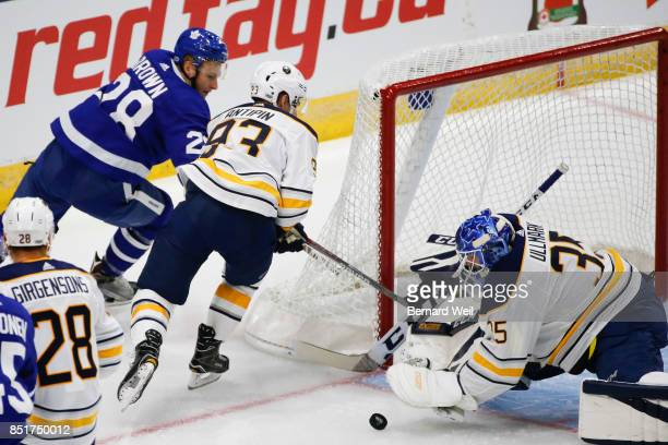 TORONTO ON SEPTEMBER 22 Leafs' Connor Brown can't make the shot as Sabres' Victor Antipin keeps him at bay as goalie Linus Ullmark makes the stop in...