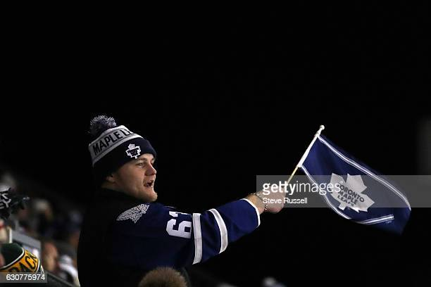 TORONTO ON JANUARY 1 Leafs fan cheers as the Toronto Maple Leafs beat the Detroit Red Wings 54 in overtime the Centennial Classic at Exhibition...