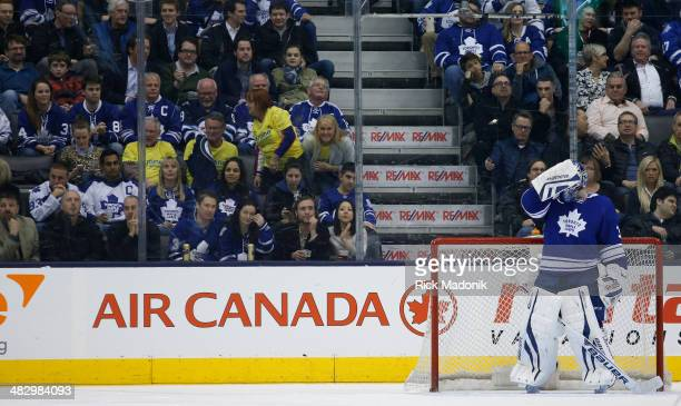 TORONTO APRIL 5 Leafs goalie James Reimer puts his mask back on after the Jets net their 4th goal Toronto Maple Leafs vs Winnipeg Jets during 3rd...