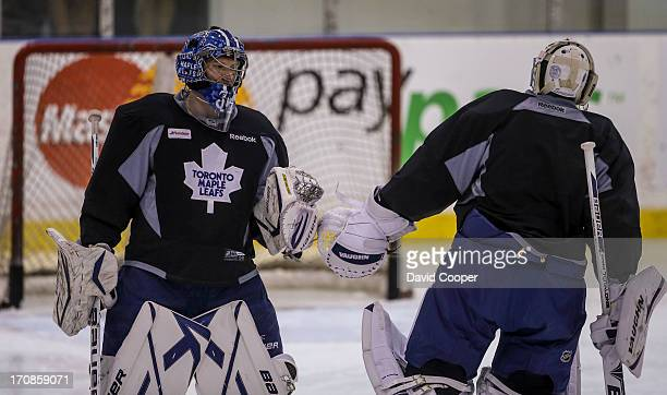 Leaf's goalies James Reimer and Ben Scrivens right tap catchers during practice at the MasterCard Centre for Hockey Excellence January 15 2013 DAVID...
