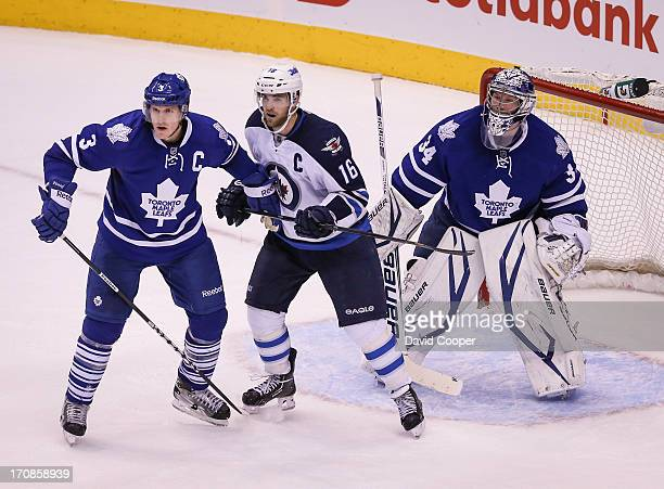 Leafs James Reimer follows the action along with Dion Phaneuf and Jets captain Brandon Sutter in the 3rd period after he replaced Ben Scrivens in the...
