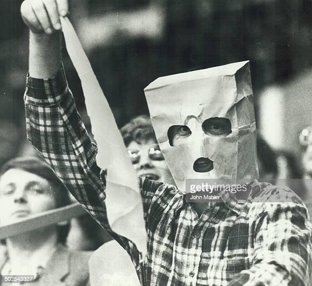 Leafs were so bad last night that one fan had to resort to a gas mask while another donned a paper bag and waved a white flag of surrender