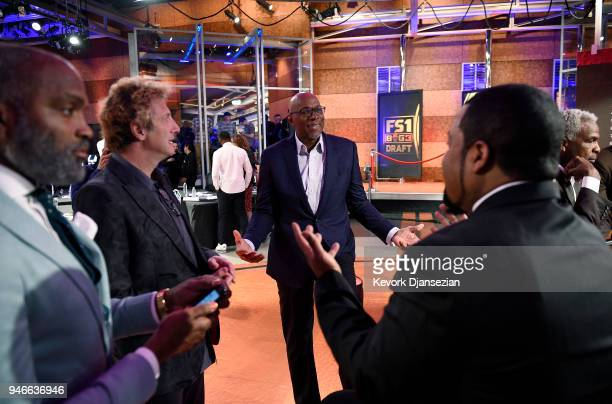 League commissioner Clyde Drexler speaks with BIG3 League cofounders Jeff Kwatinetz and Ice Cube as Power team cocaptain Cuttino Mobley looks on...