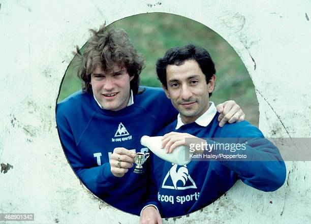 A League Cup Final media day at Tottenham Hotspur with Spurs' Osvaldo Ardiles pouring milk into a miniature trophy being held by Glenn Hoddle circa...